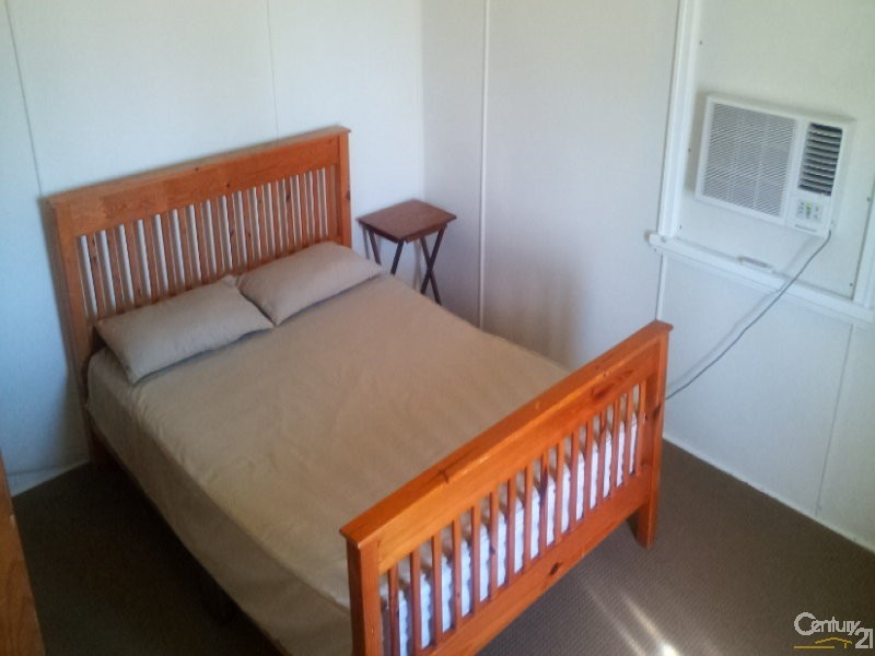 Main bedroom with built in airconditioner - 17 Brisbane Street, Bowen - House for Sale in Bowen