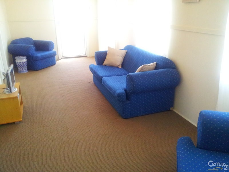 Lounge room zone with recently new carpet - 17 Brisbane Street, Bowen - House for Sale in Bowen