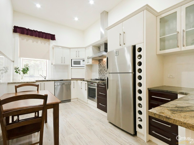 Updated modern Galley style kitchen with Marble bench tops - 10 Harrold Street, Largs Bay - House for Sale in Largs Bay