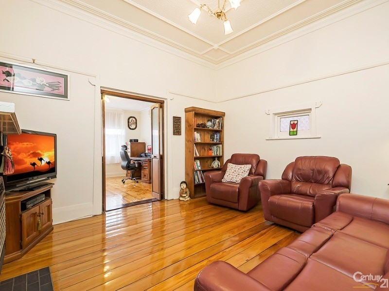 Family lounge room located off front office/study, with gas fire and small picture window - 10 Harrold Street, Largs Bay - House for Sale in Largs Bay