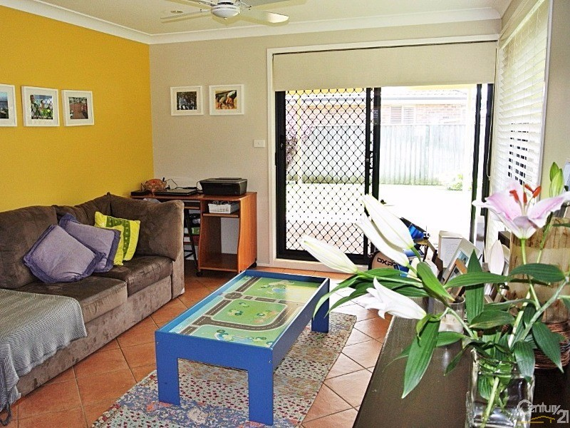 Family room opens to pergola and back yard - 4 Fidden Place, Tea Gardens - House for Sale in Tea Gardens