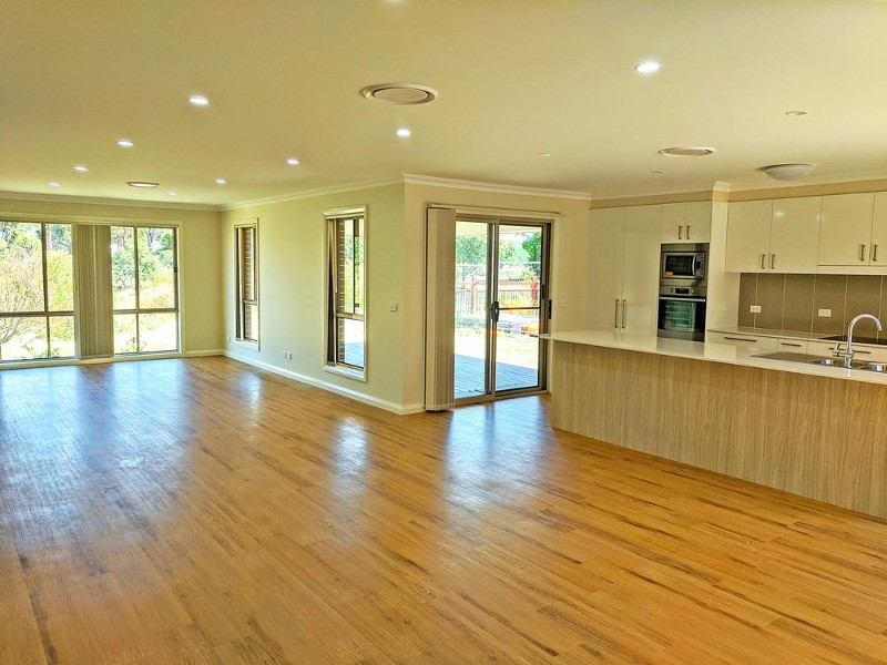 State of the art kitchen features in this massive living area with green & water views over the reserve - 25 Leeward Ct, Tea Gardens - House for Sale in Tea Gardens