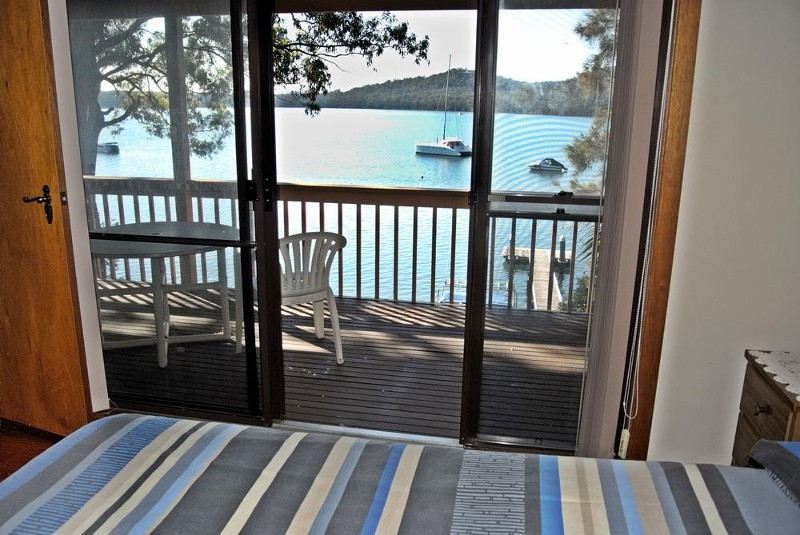 bedroom with view and balcony access - 116 Cove Boulevard, North Arm Cove - House for Sale in North Arm Cove
