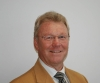 John Chamberlain - Real Estate Agent Orange